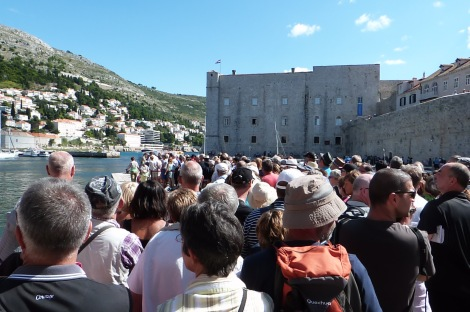 Daytrippers from cruise boats queueing to be ferried back