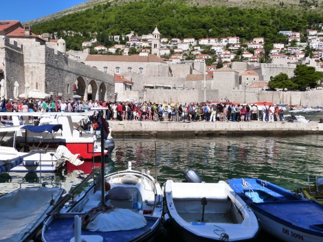 Queue of day trippers returning to cruise boats